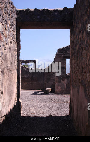 Roman doorway at the Temple of Jupiter at The City of Pompeii, Italy. - Stock Photo