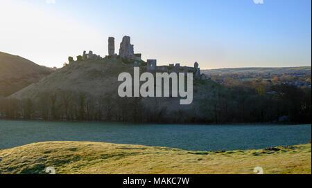 Spring sunrise over Corfe Castle, Purbeck, Dorset, UK - Stock Photo