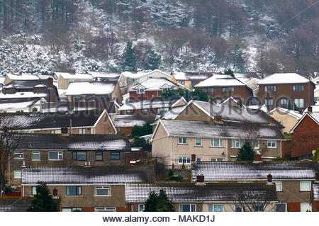 Houses on a council estate covered in snow in the wintertime south wales uk - Stock Photo