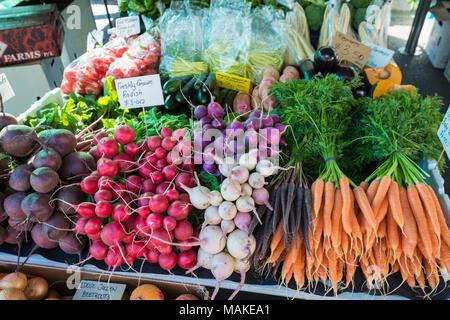 Fresh colourful vegetables on sale in stalls at Salamanca Market is a street market in Salamanca Place, Hobart, Tasmania, Australia - Stock Photo