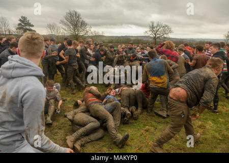 "Hallaton, Leicestershire, England, UK. 2nd April 2018. The ancient tradition of Hallaton Hare Pie Scramble and Bottle Kicking. A custom comprising of a procession followed by a charity dole administered by the local Vicar. There then follows a ""ballgame"" played with small wooden casks called bottles between two local villages, Hallaton and Medbourne. There are few if any rules and play can be fierce. Credit Haydn Denman/Alamy Live News. - Stock Photo"