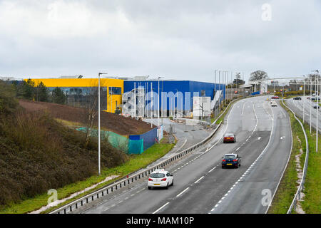 Exeter, Devon, UK. 2nd April 2018.  Constuction of the new £80 million IKEA store at Newcourt Way at Exeter in Devon approaching completion ahead it opening on 10th May.  Originally it was announced that it would open on May 1st but the opening has been delayed by 10 days due to the recent 'Beast from the East' cold spells March.  It is the 21st IKEA store to open in the UK and will be the retailers most sustainable store to date.  Picture Credit: Graham Hunt/Alamy Live News - Stock Photo