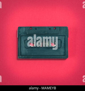 heart shape from cassette tape over paper background, top view - Stock Photo