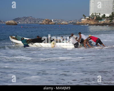 Motor boat used for fishing and tourist excursions of Pacific Ocean bay in ACAPULCO in MEXICO, sandy beach landscape - Stock Photo