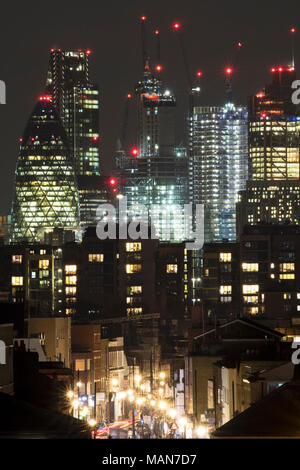 City of London at night, showing the different building heights and layers of London, and the variety of different lights that construct the skyline - Stock Photo