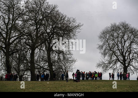 Spectators gather at the hill top outside Hallaton before the annual easter monday contest with rivals from the nearby village of Medbourne in a rough - Stock Photo