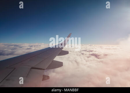 Flying above the clouds. view from the airplane - Stock Photo