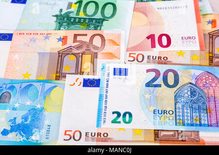 Money background from paper currency of different euro banknotes - Stock Photo