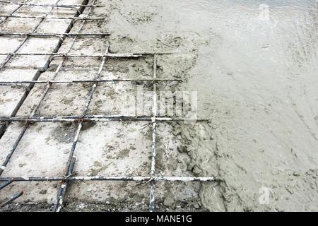 Concrete slab paving on hollow core slab flooring. - Stock Photo
