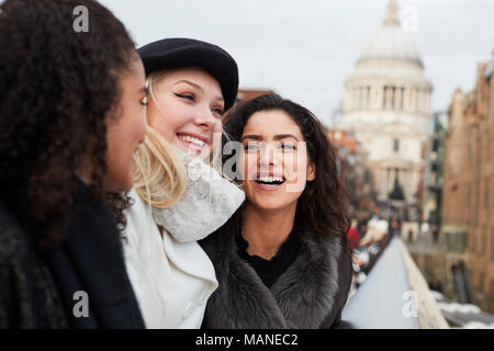 Group Of Young Female Friends Visiting London In Winter - Stock Photo