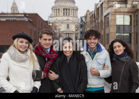 Portrait Of Young Friends Visiting London In Winter - Stock Photo