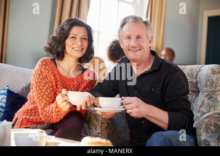Portrait Of Middle Aged Couple Meeting In Coffee Shop - Stock Photo