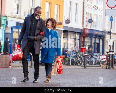 Mature Couple Enjoying Shopping In City Together - Stock Photo