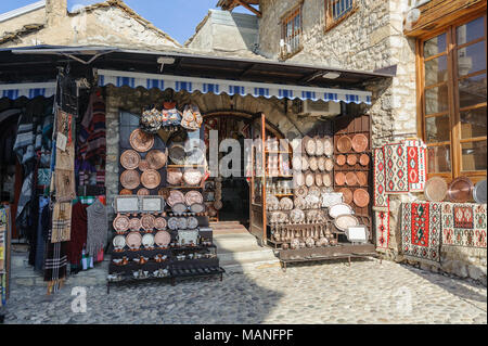 "MOSTAR, BOSNIA - JAN 26, 2018: Open Street touristic market in the old Town, Mostar in Bosnia-herzegovina. The name Mostar itself means 'bridge-keeper"" - Stock Photo"