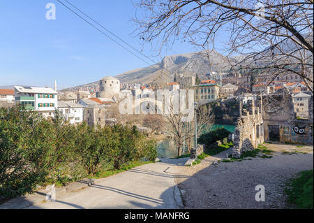 MOSTAR, BOSNIA - JAN 26, 2018: Stari Most (Old Bridge) is a rebuilt 16th-century Ottoman bridge in the city of Mostar in Bosnia that crosses the river Neretva and connects the two parts of the city. - Stock Photo