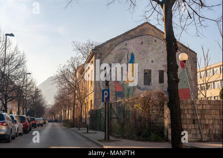 MOSTAR, BOSNIA - JAN 26, 2018: Street with mural painting in the Old Town, Mostar in Bosnia-herzegovina. The name Mostar itself means bridge-keeper - Stock Photo