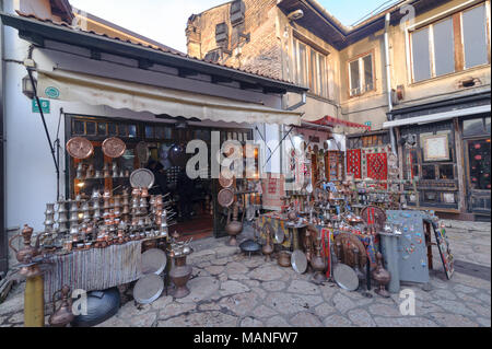 SARAJEVO, BOSNIA - JAN 26, 2018: Open Street touristic market in the old Town, Sarajevo in Bosnia-herzegovina. Old Style handmade copper products are very famous. - Stock Photo