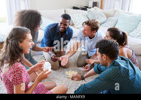 Group Of Friends At Home Playing Cards Together Stock Photo