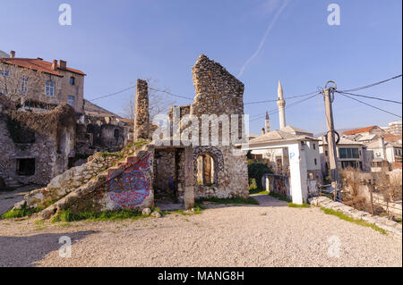 MOSTAR, BOSNIA - JAN 26, 2018: Ruin house with mural painting in the Old Town, Mostar in Bosnia-herzegovina. There are many ruin old houses destructed by Serbian bombing in the old city - Stock Photo