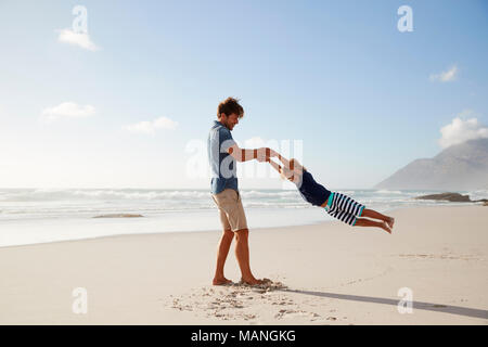 Father Having Fun With Son On Summer Beach Vacation - Stock Photo
