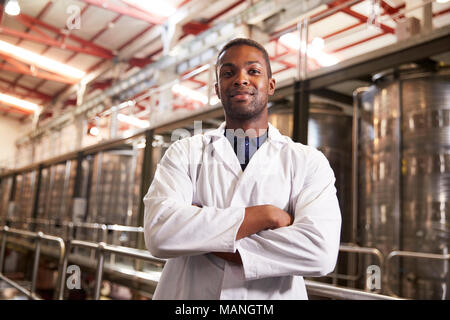 Portrait of a young black male technician at a wine factory - Stock Photo