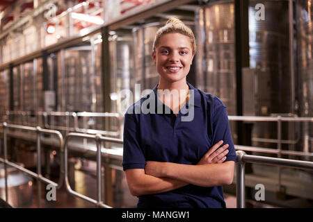 Portrait of a young white woman working at a wine factory - Stock Photo