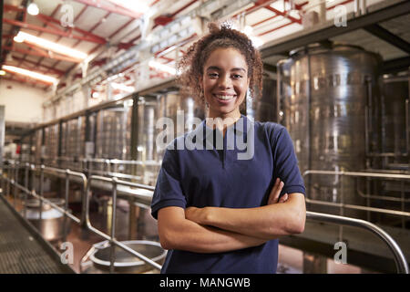 Portrait of young mixed race woman working at a wine factory - Stock Photo