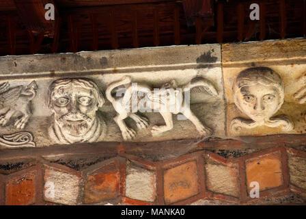 Sculptures. Cloister of cathedral Notre Dame, Le Puy en Velay,  Haute Loire, Auvergne, France, Europe - Stock Photo