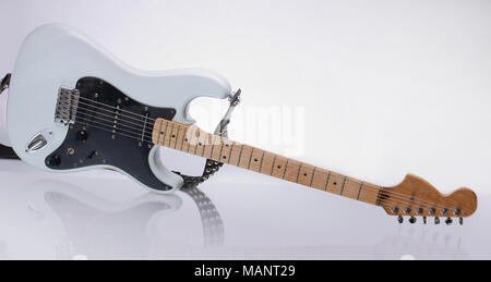 closeup.stylish guitar with reflection. isolated on a white - Stock Photo