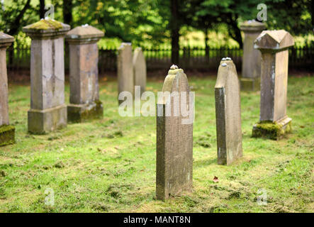 Jewish cemetery with old, mossy tombstone and selective focus. Jewish culture. - Stock Photo