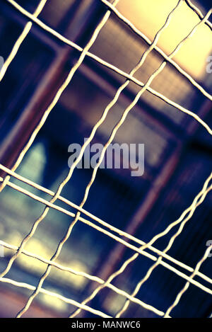 Fence with hole, wire fence, jail break scene. - Stock Photo