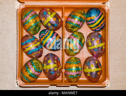 foil wrapped mini chocolate easter eggs in box - Stock Photo