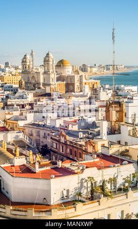 Cadiz cityscape with famous Cathedral called Catedral de la Santa Cruz sobre las Aguas de Cádiz, Andalusia, Spain - Stock Photo