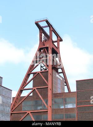 Zeche Zollverein, unesco heritage in Essen, Ruhrgebiet. Famous place, old coal mine shaft and blue sky. - Stock Photo