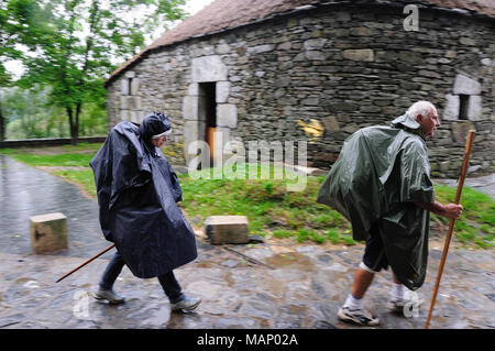Way of St. James's pilgrims arriving at O Cebreiro. Galicia, Spain - Stock Photo