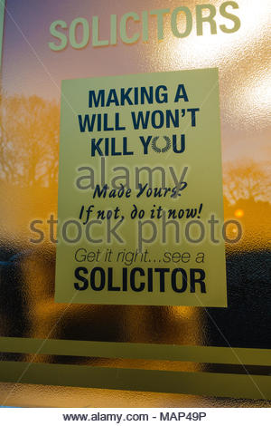 Solicitors frosted glass window etched with a statement, stating 'making a will won't kill you' & 'made yours? If not do it now!' 'Get it Right See a  - Stock Photo