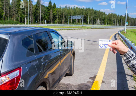 Moscow, Russia - August 31, 2017: Road ticket for toll road Russian highway number M11 in summer day. Text in Russian: Road ticket - Stock Photo