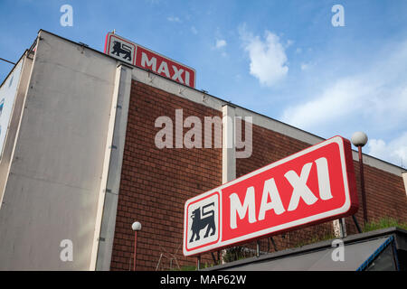 BELGRADE, SERBIA - MARCH 30, 2018: Entrance of a Maxi Supermarket with its logo. Belonging to the Belgian group Delhaize, Maxi Supermarkets is the lea - Stock Photo
