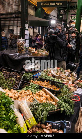 Fresh produce on market stall with camera man, Borough Market, Southwark, London, England, UK - Stock Photo