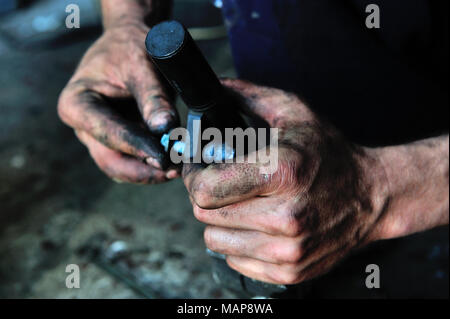 a person, a working, arm, black works, craftemployment, illegally employment, illicit workprofessional life, professionally, hard, danger, work - Stock Photo