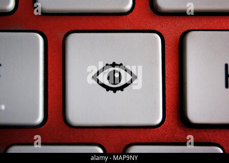 Image of eye icon on computer keyboard button - Stock Photo