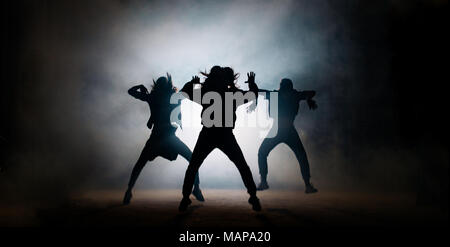 Group of young hip-hop dancers performing on the stage - Stock Photo
