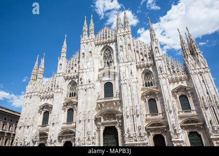 Milan, Milan Province, Lombardy, Italy.  Facade of the Duomo, or cathedral, in the Piazza del Duomo. - Stock Photo