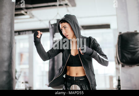 side view image of MMM fighter with ready to repulse an opponent - Stock Photo
