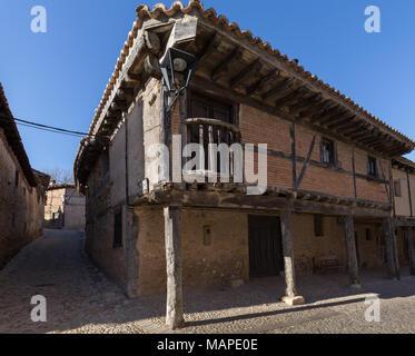 Facade of an ancient building in Calatanazor, Soria - Stock Photo