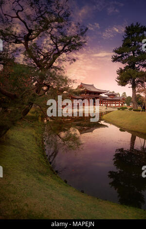 Jodo-shiki garden, Jodoshiki teien, Pure Land garden with a pond in front of the Phoenix Hall, Amida hall of Byodo-in Buddhist temple. Beautiful sunse - Stock Photo