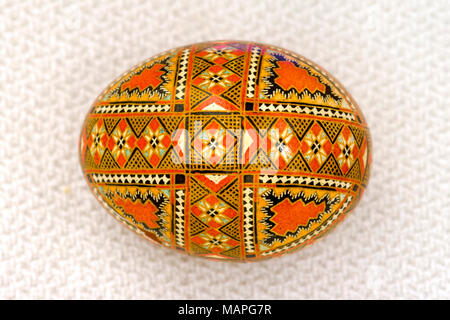 Pysanka (Ukrainian Easter egg), intricately inscribed. - Stock Photo