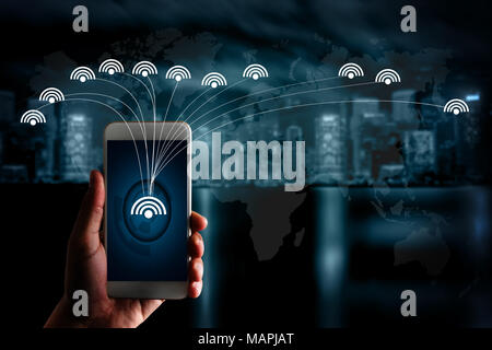 internet iot man  use smartphone internet of things technology (IoT) word diagram as concept - Stock Photo