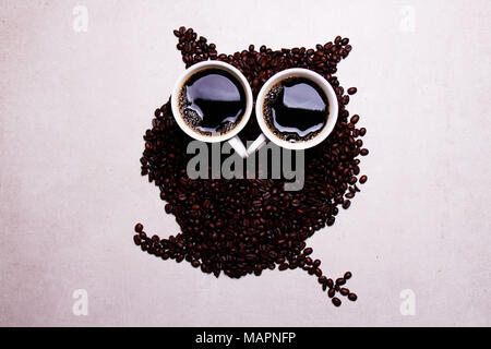 coffee beans forming an owl, good morning and stay fit - Stock Photo