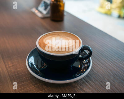 Coffee late art in cup on table, image coffee  heart, - Stock Photo